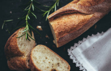French baguette, fresh crunchy white bread, baked french pastry rustic style. European food culture